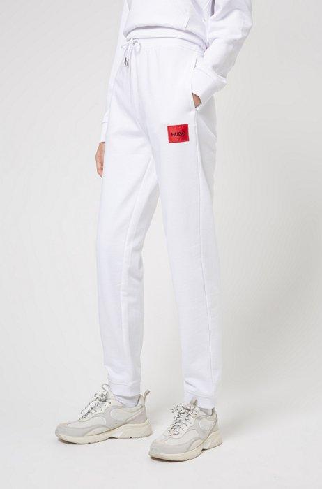 Pantaloni della tuta in terry di cotone con etichetta con logo, Bianco