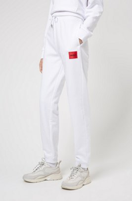 Cotton-terry tracksuit bottoms with red logo label, White