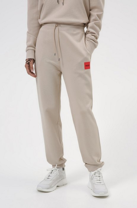 Cotton-terry tracksuit bottoms with logo label, Light Beige