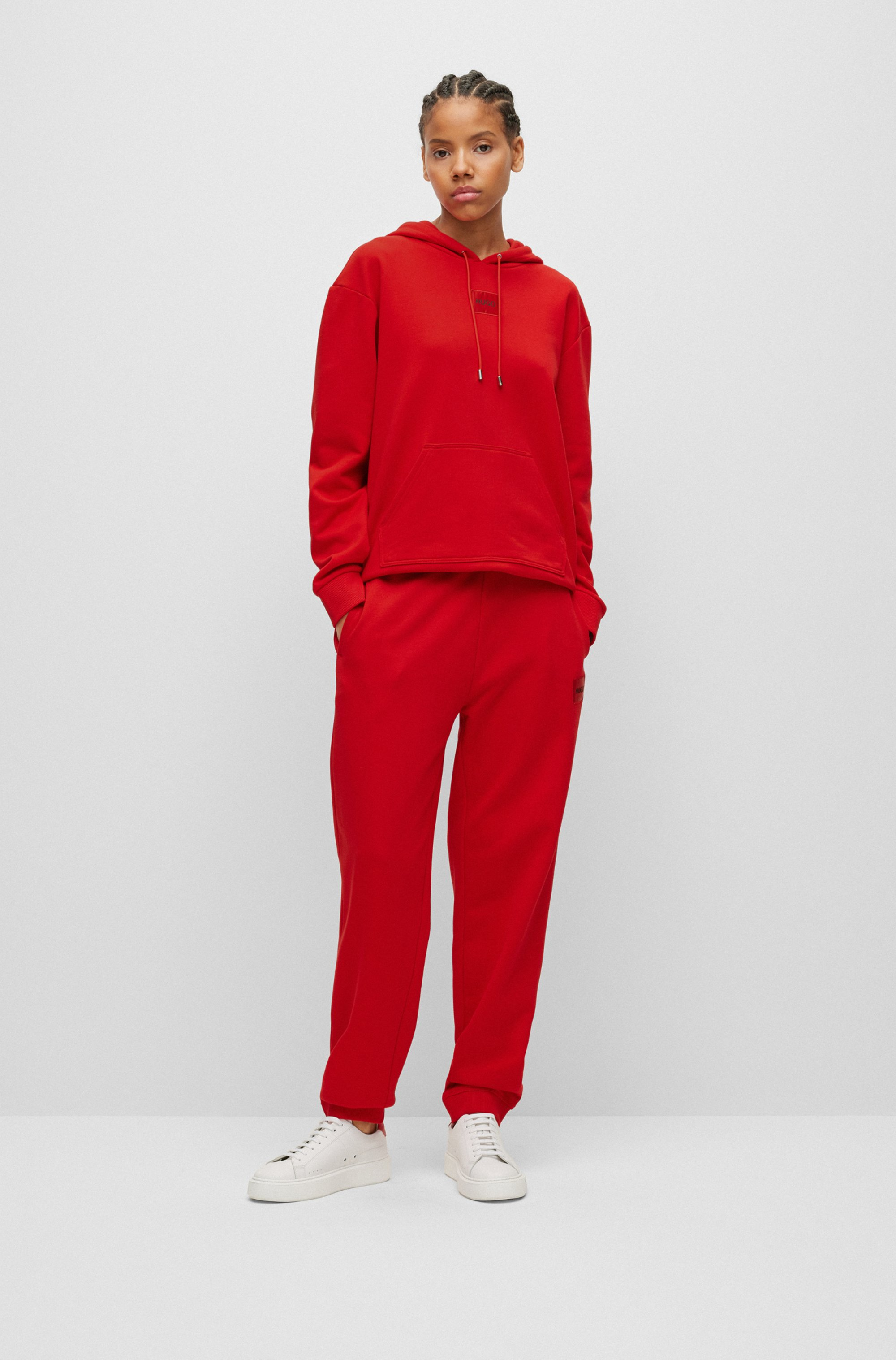 Cotton-terry tracksuit bottoms with red logo label