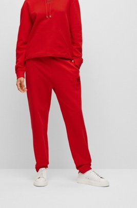 Cotton-terry tracksuit bottoms with red logo label, light pink