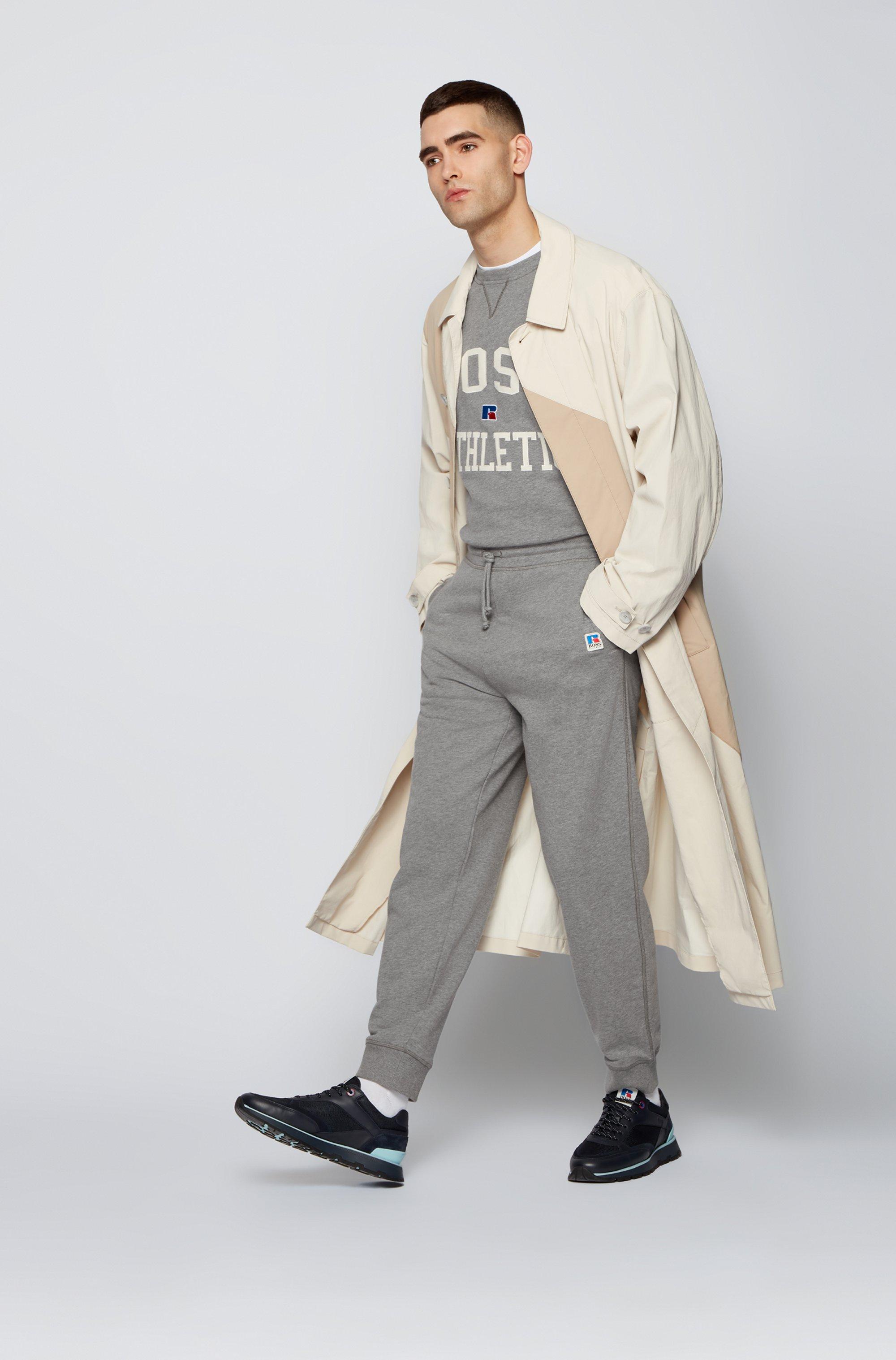 Sudadera unisex relaxed fit en algodón orgánico con logo exclusivo