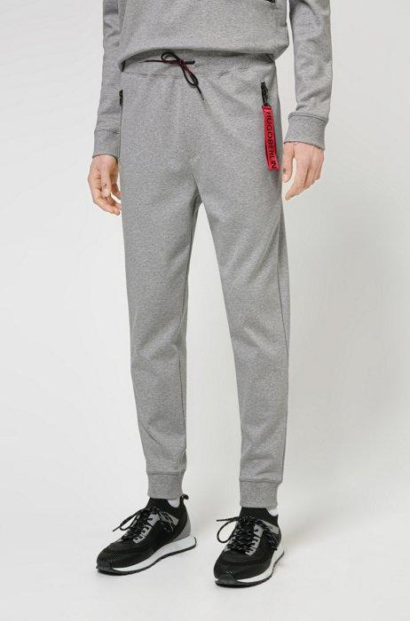 Interlock-cotton tracksuit bottoms with reverse-logo patch, Light Grey