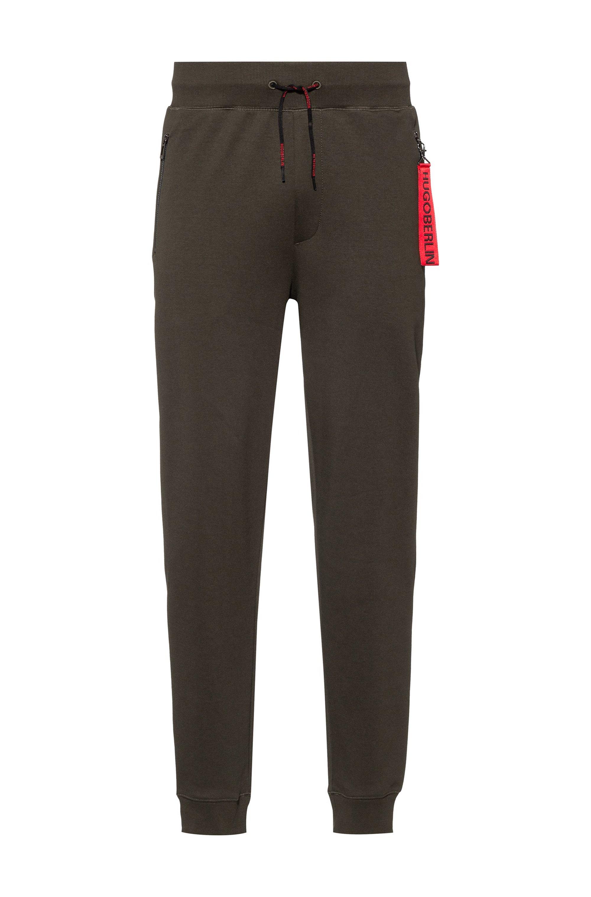 Interlock-cotton tracksuit bottoms with reverse-logo patch, Khaki