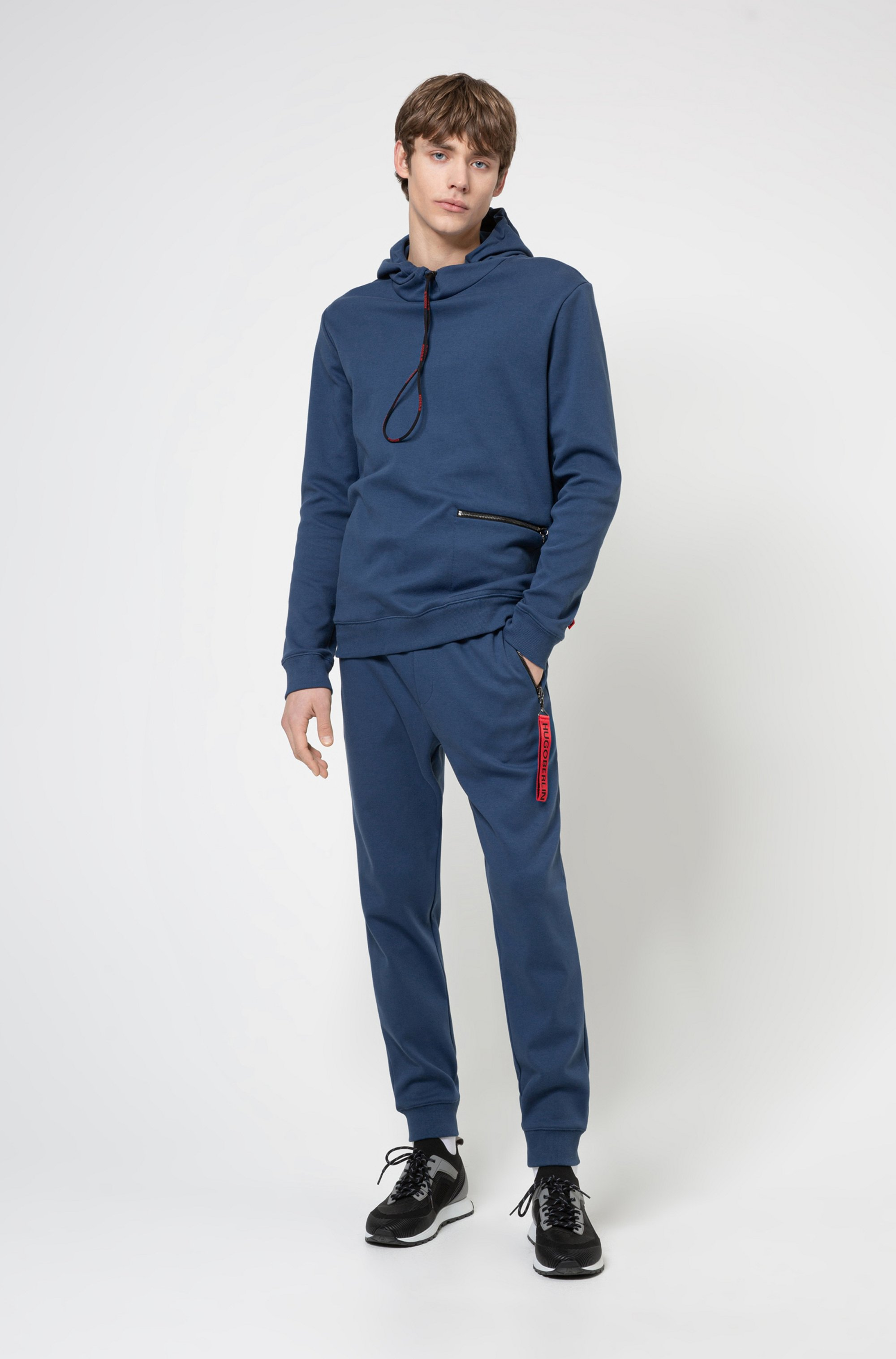 Interlock-cotton tracksuit bottoms with reverse-logo patch