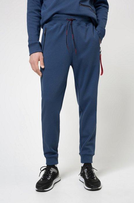 Jogginghose aus Interlock-Baumwolle mit spiegelverkehrtem Logo-Aufnäher, Dunkelblau