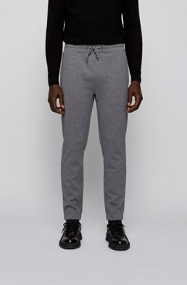 Tracksuit bottoms in double-faced jersey with logo patch, Grey