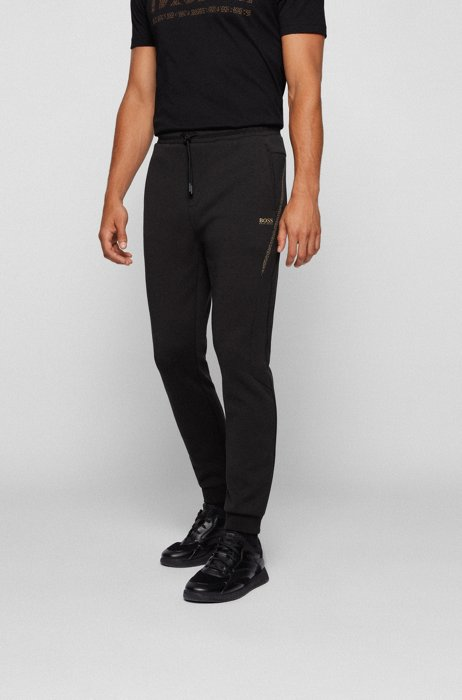 Logo tracksuit bottoms with pixel print and hemmed cuffs, Black
