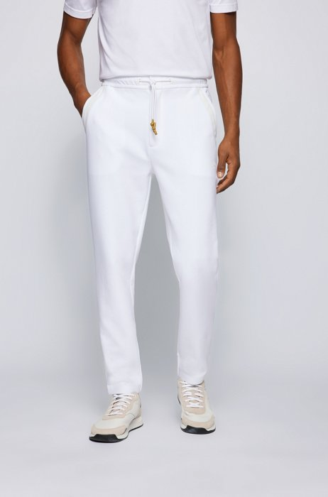 Curved-logo tracksuit bottoms in a cotton blend, White