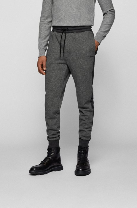 Cotton-blend tracksuit bottoms with houndstooth motif, Black