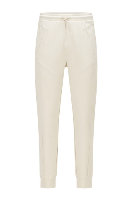 Regular-fit tracksuit bottoms in organic cotton with stretch, White