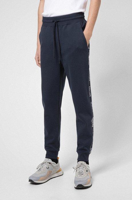 Pantalon de survêtement en coton mélangé avec logos sur les coutures latérales, Bleu foncé