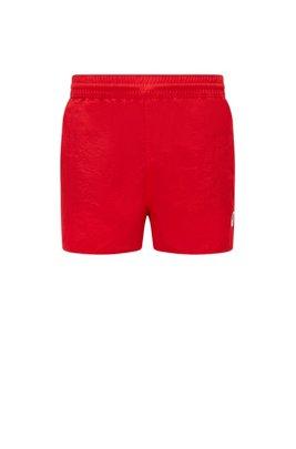 Kurze Badeshorts aus schnell trocknendem Gewebe mit exklusivem Logo, Rot