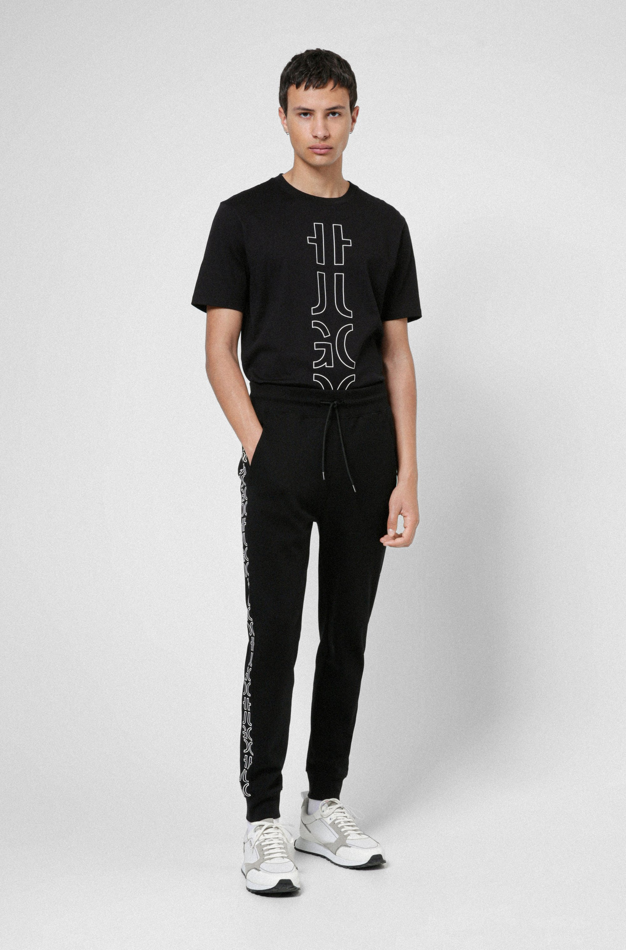 Organic-cotton tracksuit bottoms with cropped logos