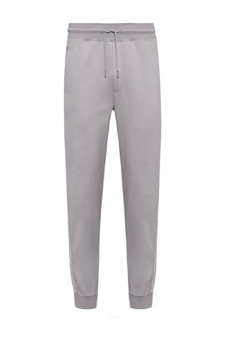 Organic-cotton tracksuit bottoms with cropped logos, Silver