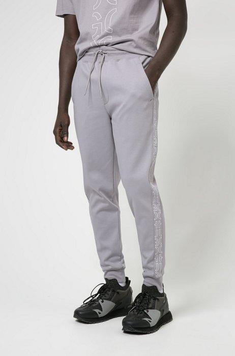 Pantaloni della tuta in cotone biologico con loghi troncati, Argento