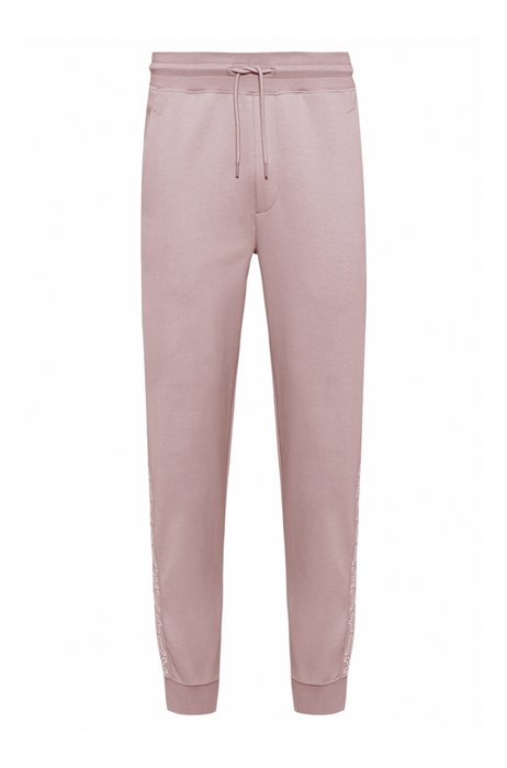 Organic-cotton tracksuit bottoms with cropped logos, light pink