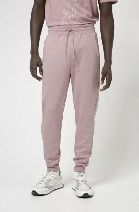 Pantalones de chándal en algodón orgánico con logos recortados, Rosa claro