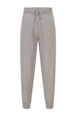 Jogginghose aus Bio-Baumwolle mit Beinbündchen und exklusivem Logo, Grau