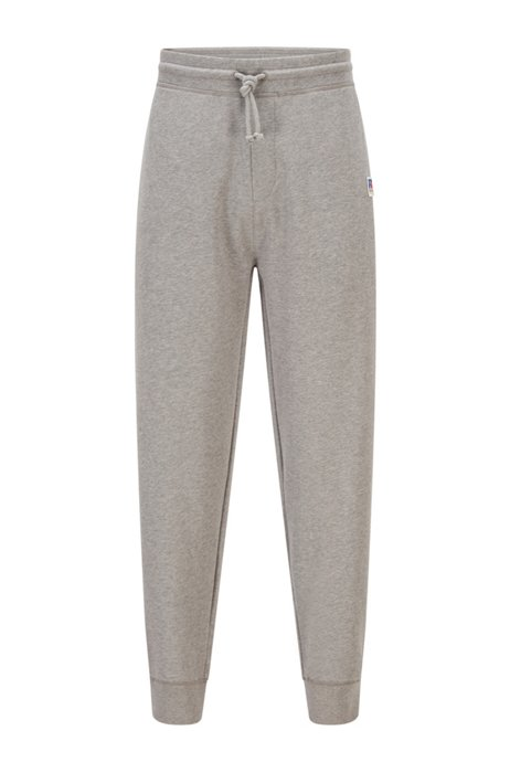 Cuffed tracksuit bottoms in organic cotton with exclusive logo, Grey