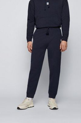 Cuffed tracksuit bottoms in organic cotton with exclusive logo, Dark Blue