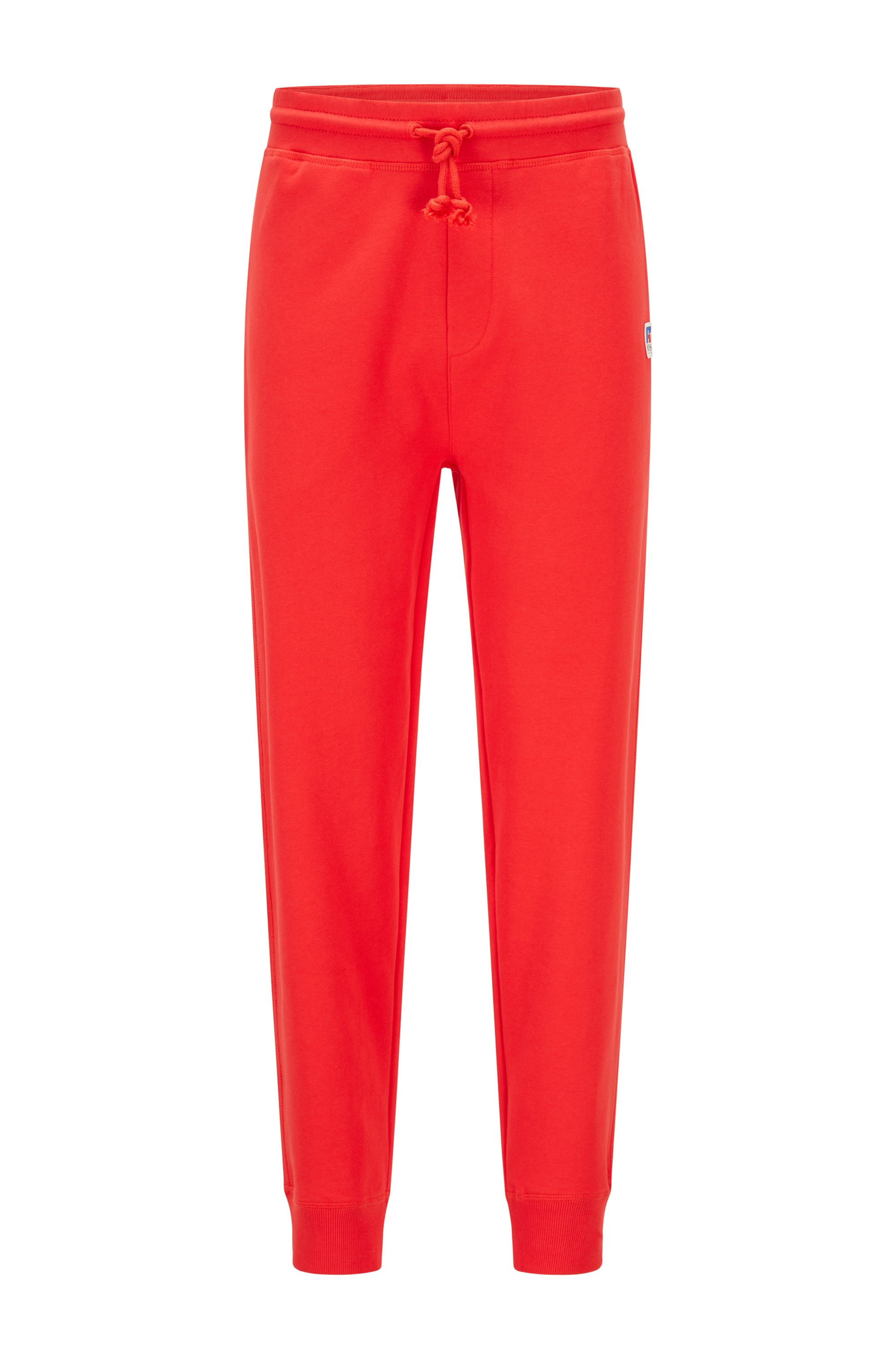 Cuffed tracksuit bottoms in organic cotton with exclusive logo, Red