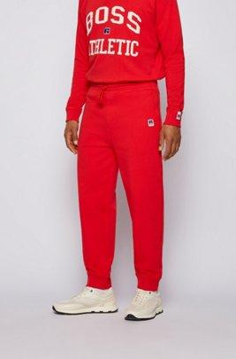 Bas de survêtement en coton biologique resserré au bas des jambes avec logo exclusif, Rouge