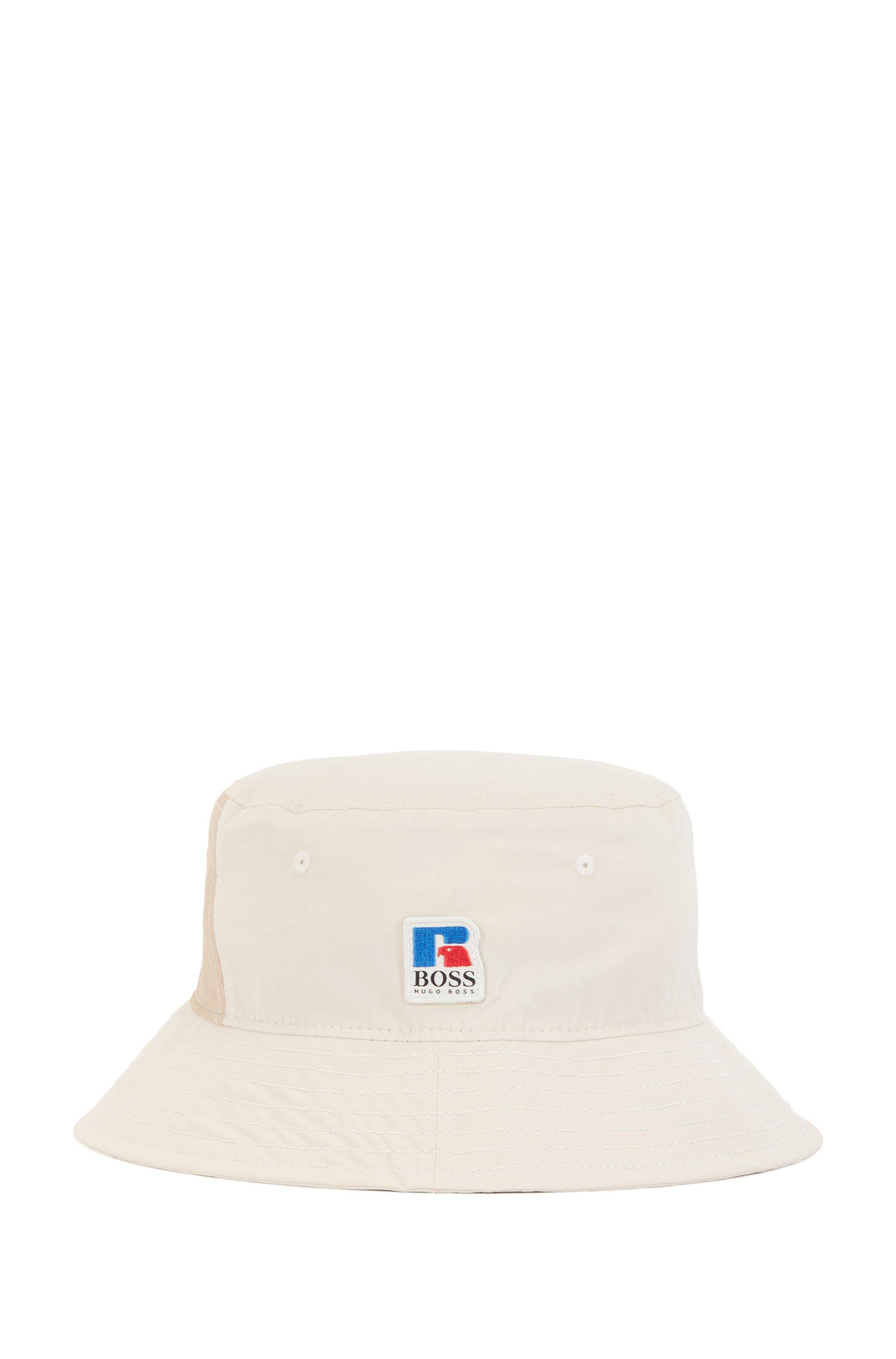 Chapeau Trilby en coton enduit avec logo exclusif, Beige clair