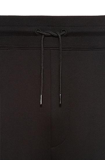 手绘徽标图案棉质束口运动裤,  001_Black