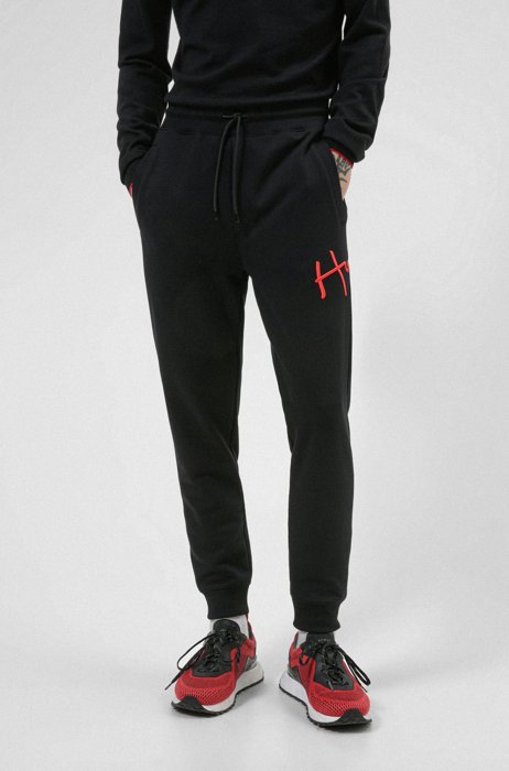 Cuffed tracksuit bottoms in organic cotton with handwritten logo, Black