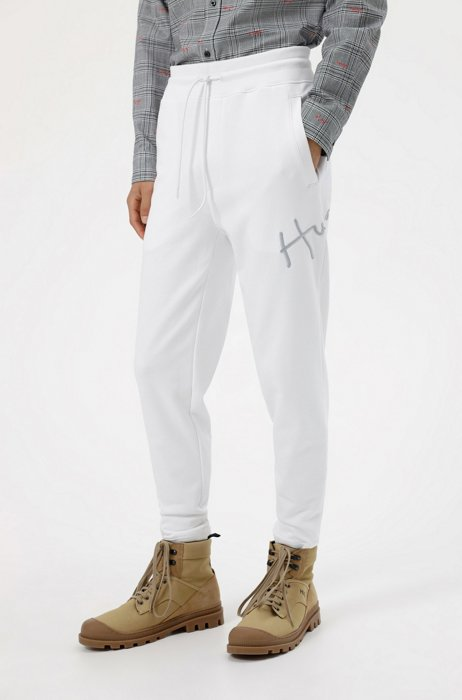 Cuffed tracksuit bottoms in organic cotton with handwritten logo, White