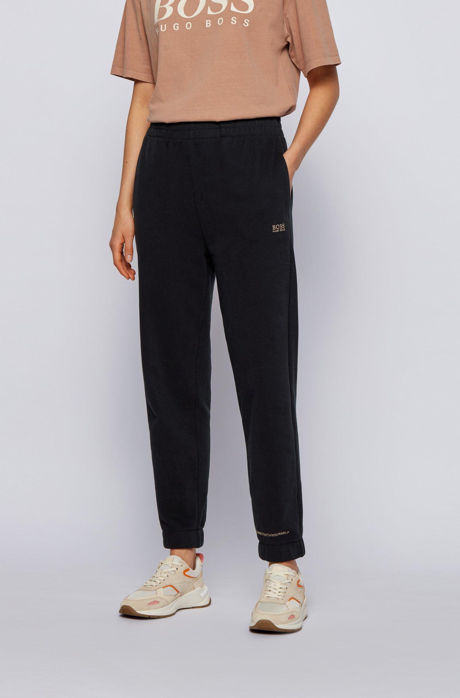Cotton-blend tracksuit bottoms with logo print, Black