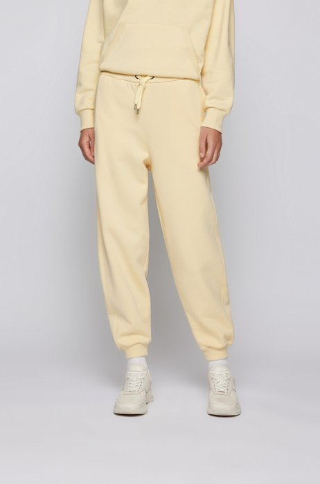 Relaxed-fit tracksuit bottoms in cotton-blend jersey, Light Yellow