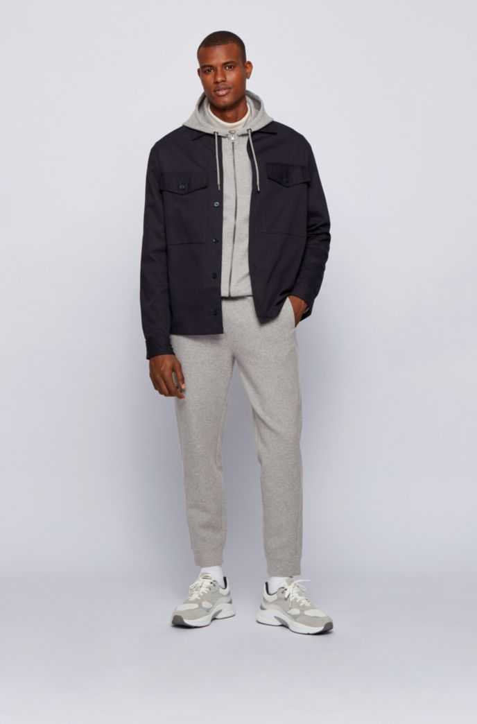 Cotton-blend interlock jersey tracksuit bottoms with embroidered logo