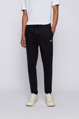 Logo tracksuit bottoms in cotton-blend French terry, Black