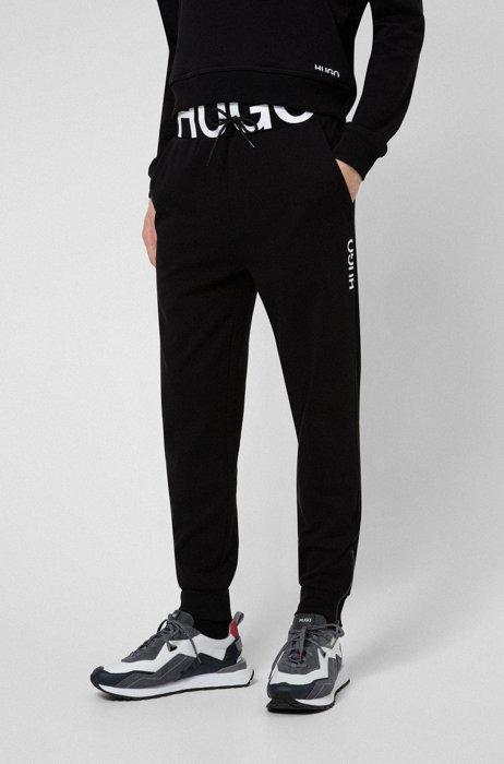 Interlock-cotton tracksuit bottoms with waistband logo, Black