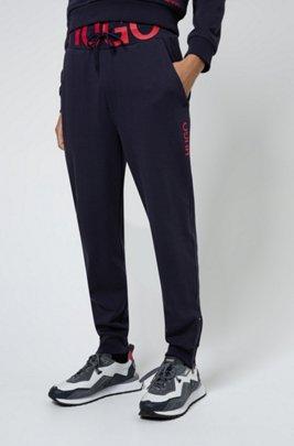 Interlock-cotton tracksuit bottoms with waistband logo, Dark Blue