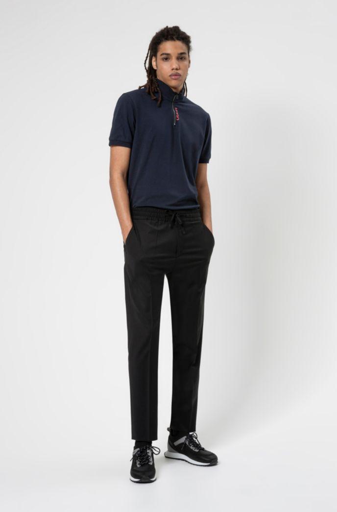 Polo en coton stretch avec encolure zippée et logo revisité