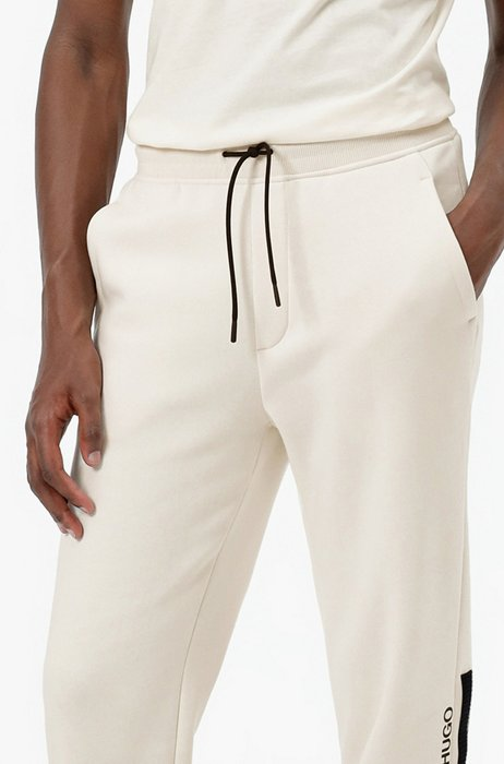 Manifesto-logo tracksuit bottoms in an organic-cotton blend, White