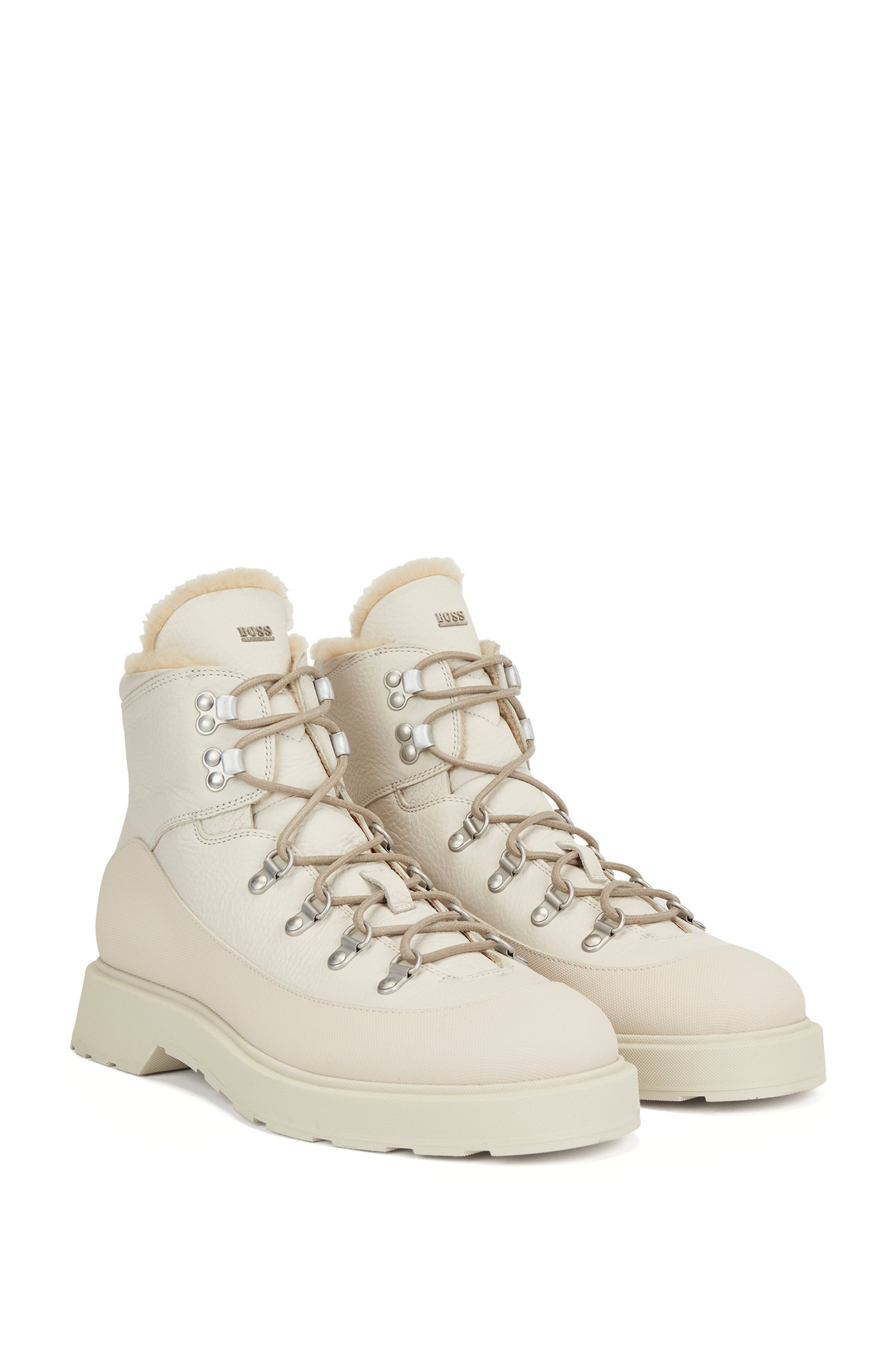Hiking-style boots in printed leather with shearling lining