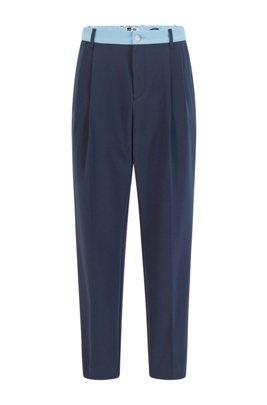 Pantalones tapered fit con ribete en contraste y logo exclusivo, Azul oscuro
