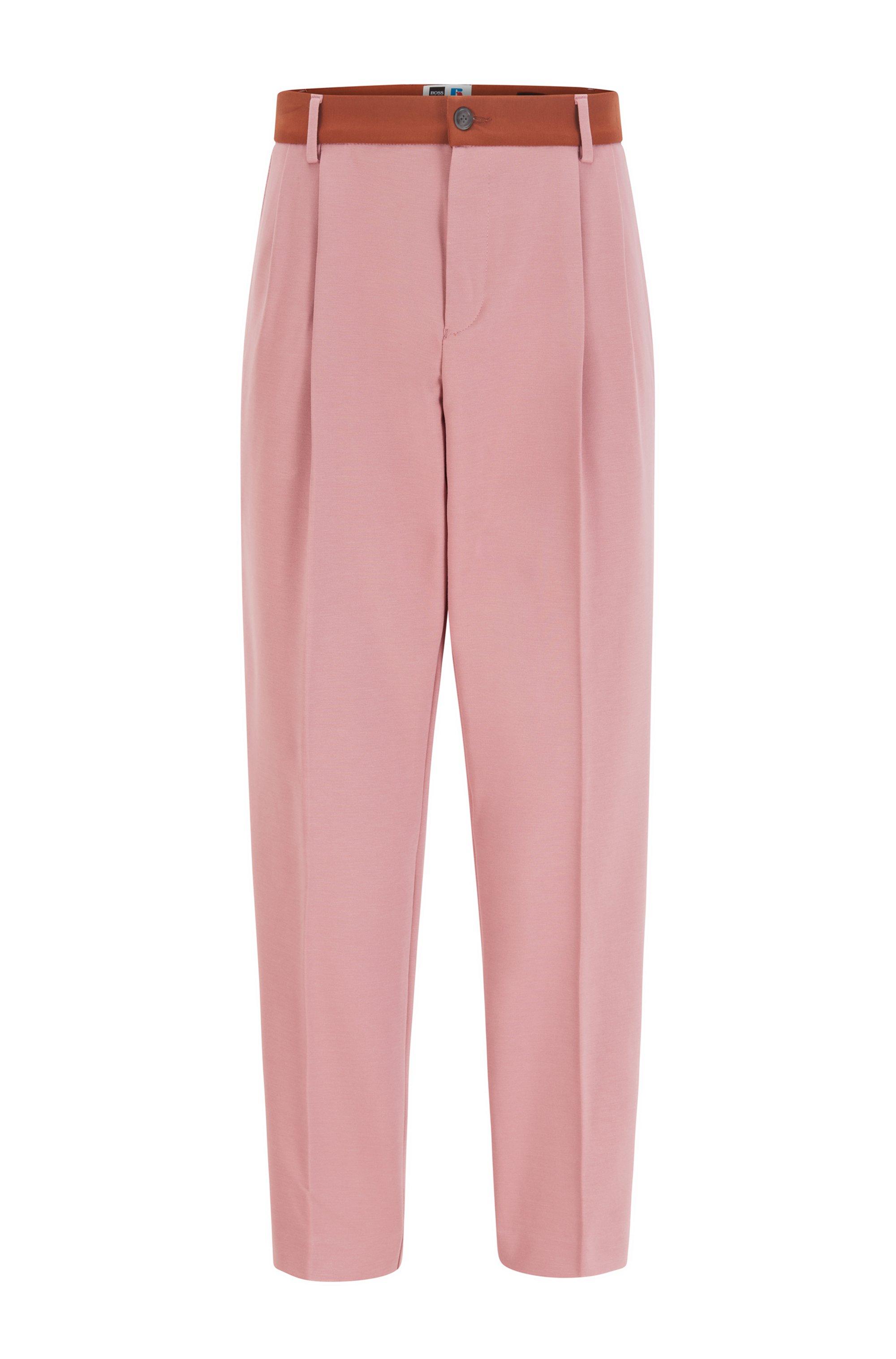 Pantalones tapered fit con ribete en contraste y logo exclusivo, Rosa claro