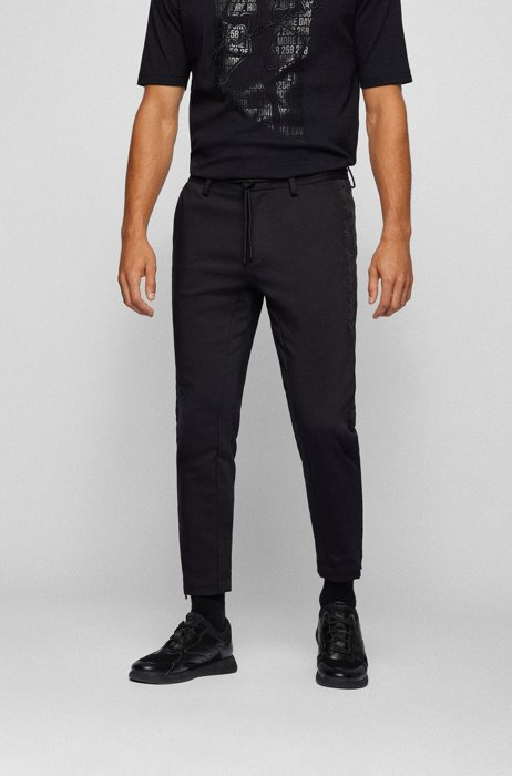 Tapered-fit tracksuit bottoms with faux-leather inserts, Black