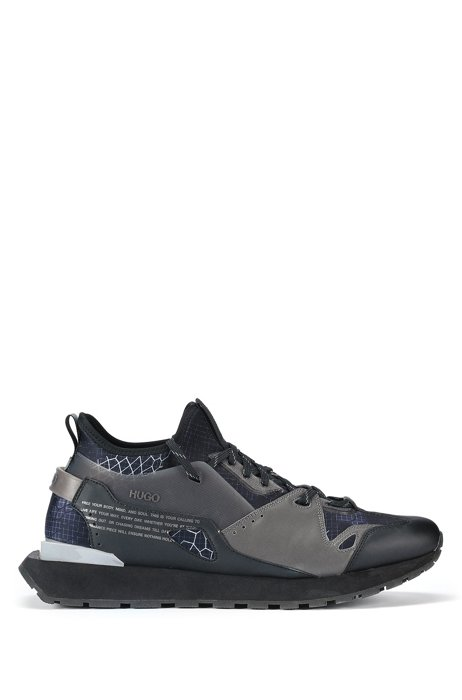Hybrid sock trainers with snakeskin pattern and manifesto print, Black