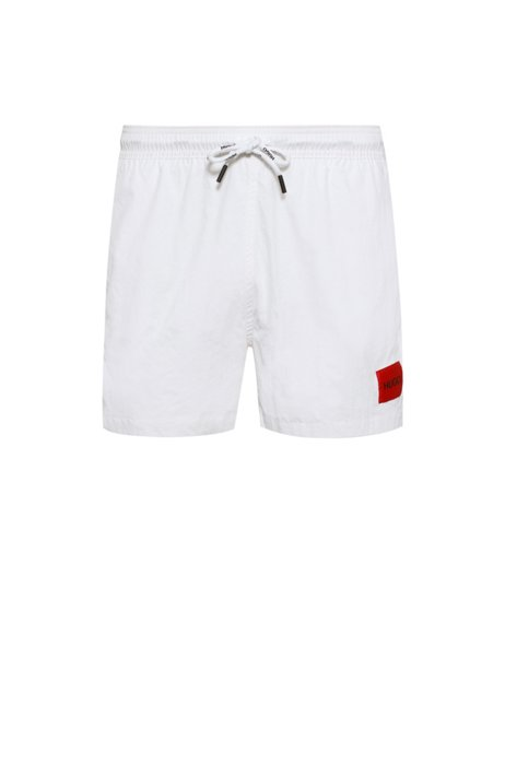 Quick-drying swim shorts in recycled fabric with logo label, White