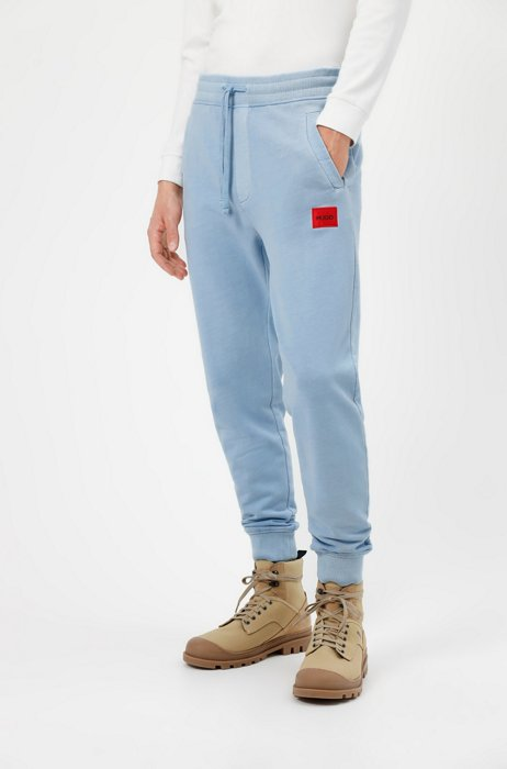 Tracksuit bottoms in terry cotton with red logo label, Light Blue