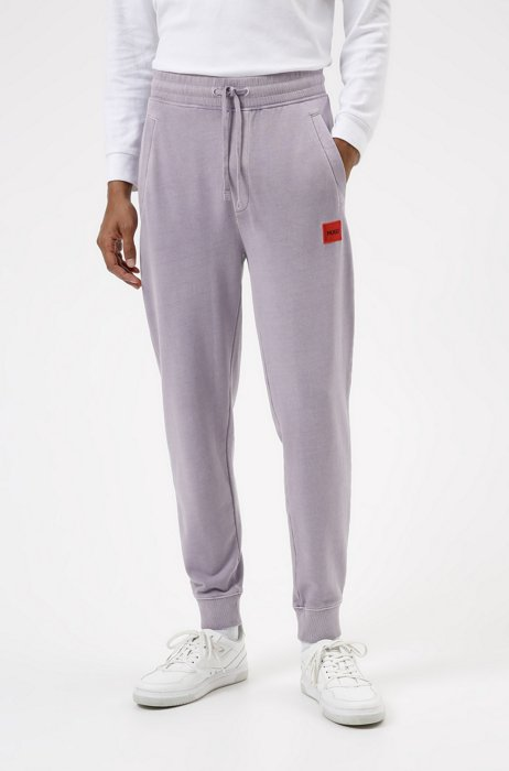 Tracksuit bottoms in terry cotton with red logo label, Light Purple