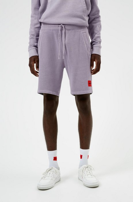 Relaxed-fit shorts in cotton with red logo label, light pink