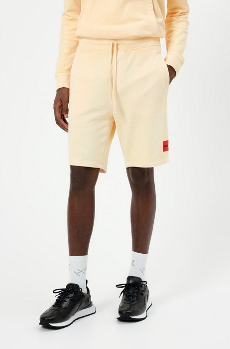 Relaxed-fit shorts in cotton with red logo label, Orange
