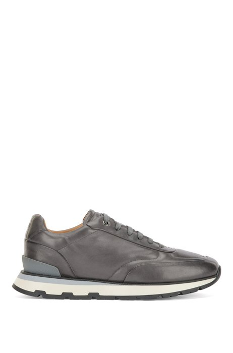 Italian-made trainers in burnished leather with monogram outsole, Dark Grey
